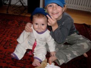 Eli and Sawyer wearing SoCal team hats.