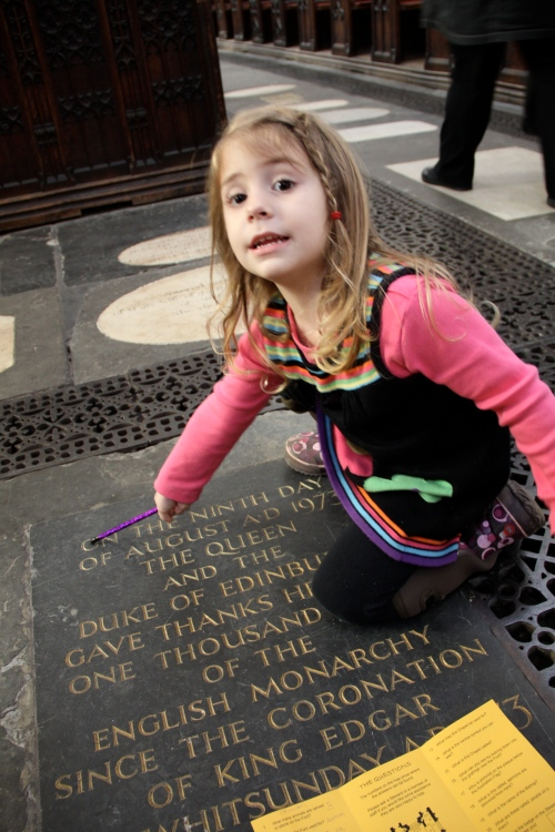 Finley pointing at a memorial in Bath Abbey.