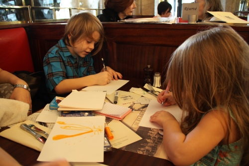 Eli and Finley Plan the Revolution At Café de Flore