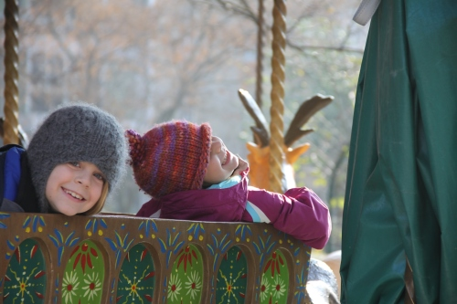 kids on the carousel outside Galerie d'Anatomie Comparée
